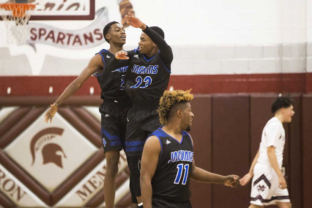 Desert Pines sophomore Dayshawn Wiley (2) celebrates with teammate Darnell Washington (13 af ...