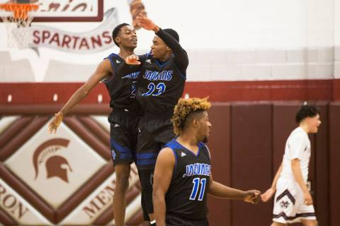 Desert Pines sophomore Dayshawn Wiley (2) celebrates with teammate Darnell Washington (13 af ...