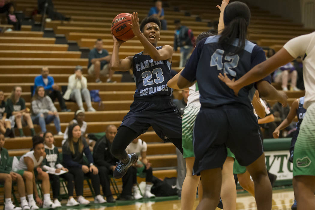 Canyon Springs guard Kayla Johnson (23) takes a shot against Green Valley during the first h ...