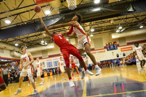 Coronado's Jaden Hardy (1) gets blocked by Bishop Gorman's Isaiah Cottrell (0) d ...