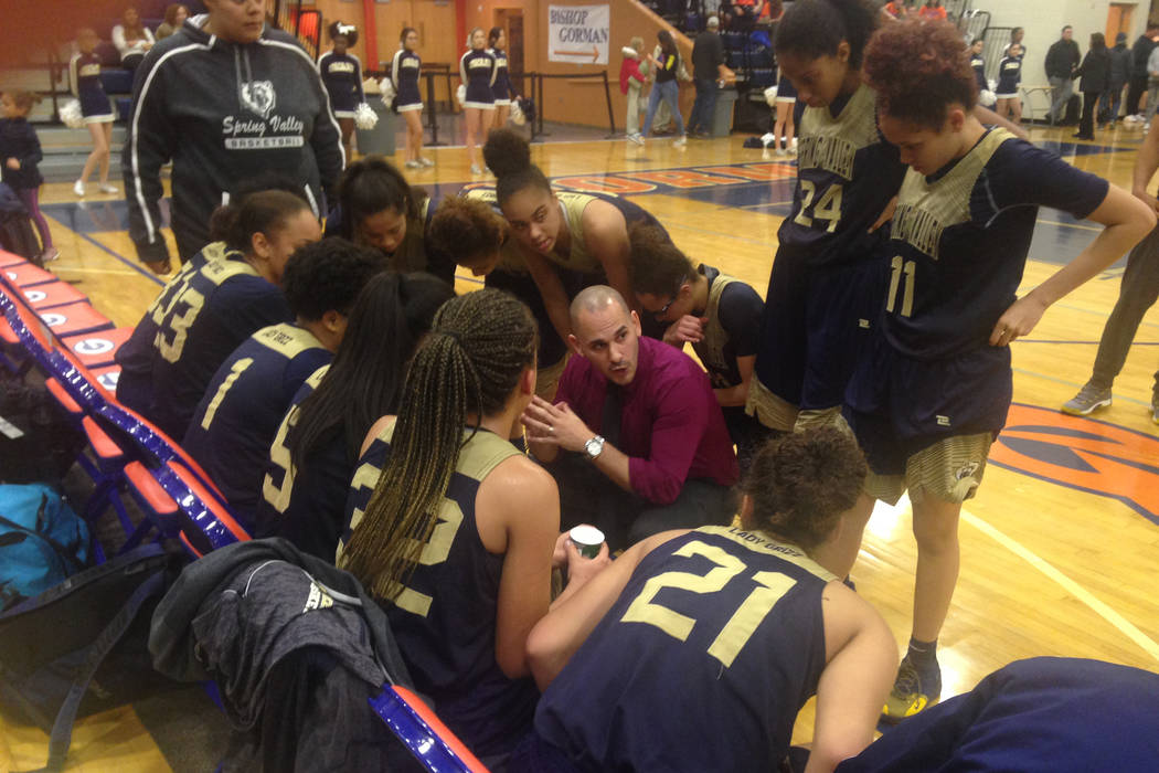 Spring Valley coach Billy Hemberger talks to his team during a timeout on Wednesday, Jan. 16 ...