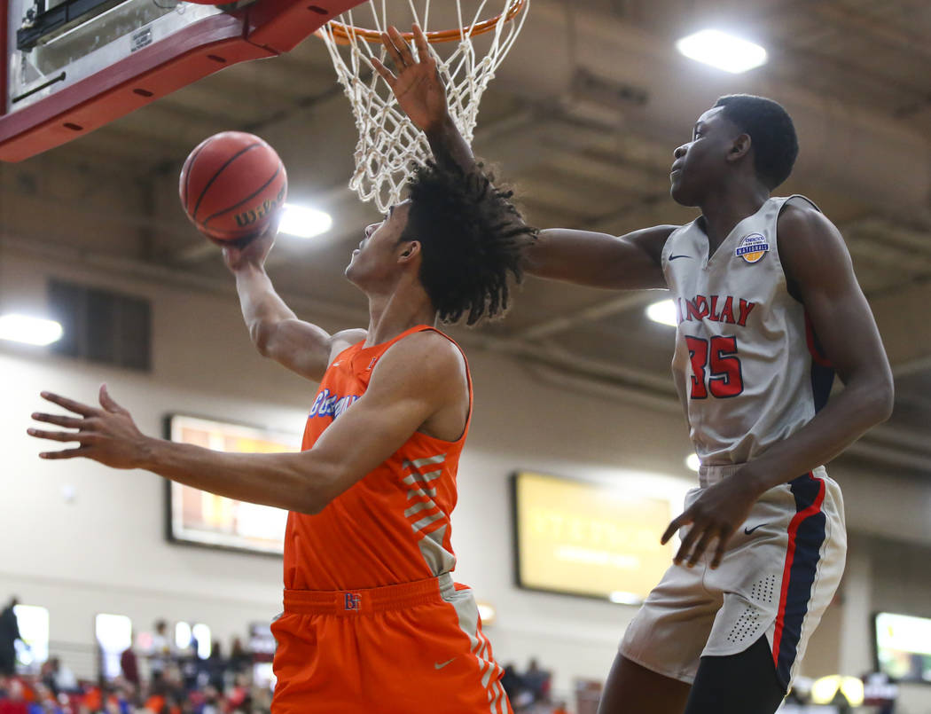 Bishop Gorman's Isaiah Cottrell goes to the basket in front of Findlay Prep's Al ...