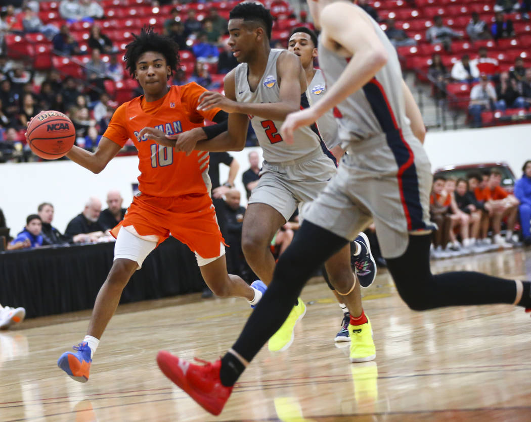 Bishop Gorman's Zaon Collins (10) drives the ball against Findlay Prep's Aston S ...