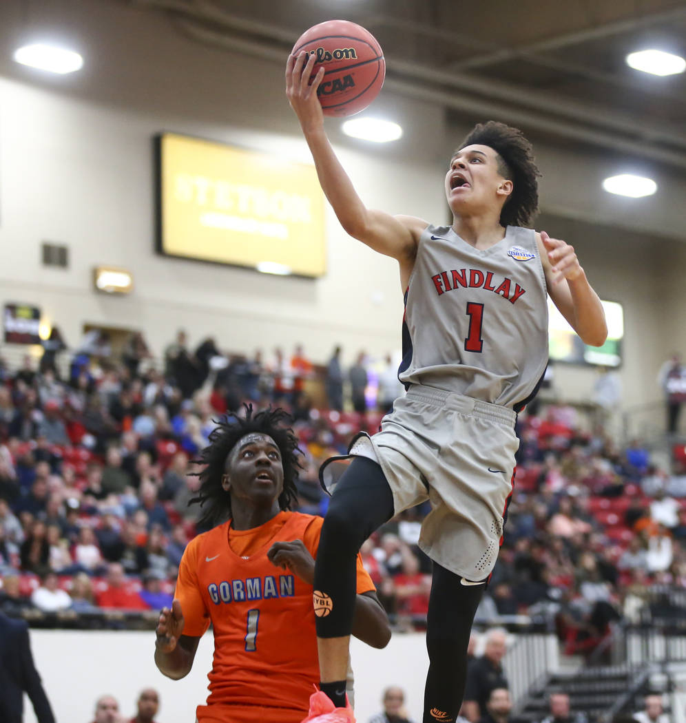 Findlay Prep's Blaise Beauchamp (1) goes to the basket over Bishop Gorman's Will ...