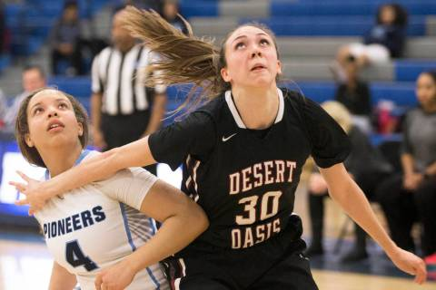 Desert Oasis senior forward Sierra Mich'l (30) boxes out Canyon Springs senior guard J ...