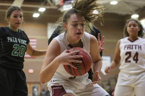 Faith Lutheran's Kelsey Howryla (34) shields the ball during a game against Palo Verde ...