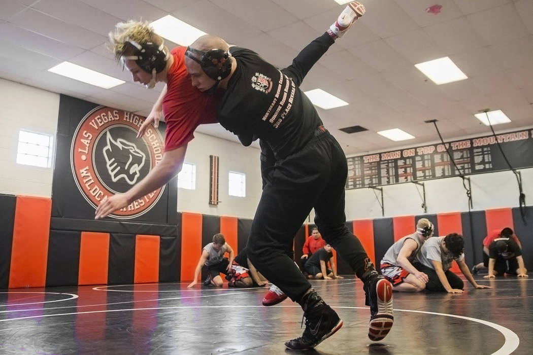 Daniel Law, right, lifts Trace Everett during wrestling practice on Friday, Jan. 25, 2019, a ...
