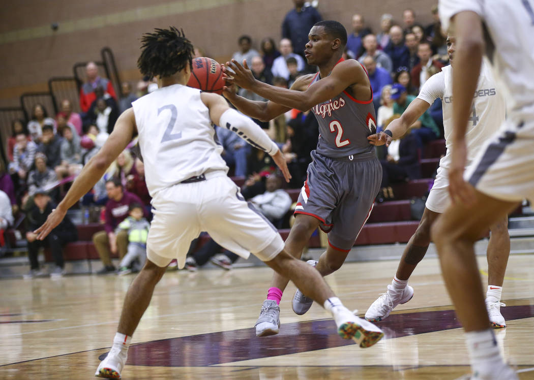Arbor View's Favor Chukwukelu (2) passes the ball during the first half of a basketbal ...