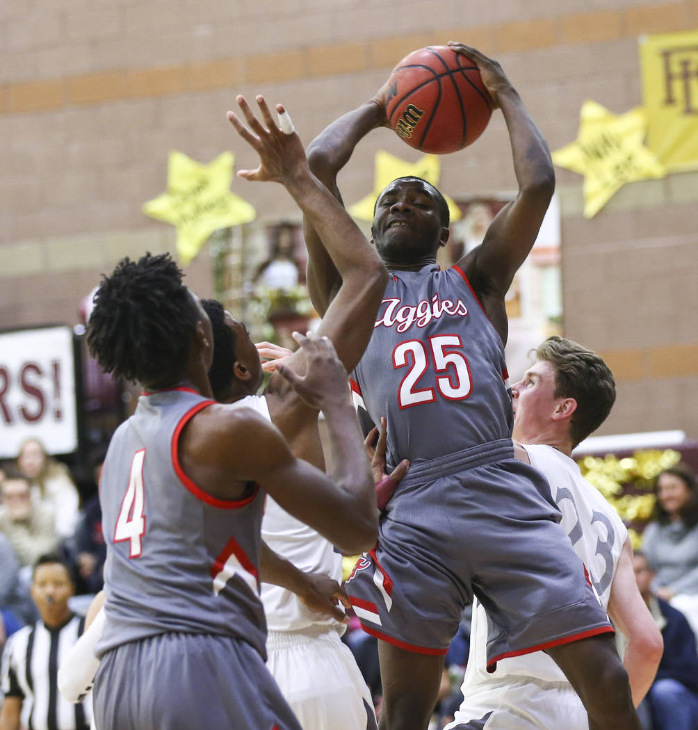 Arbor View's Larry Holmes (25) gets a rebound during the first half of a basketball ga ...