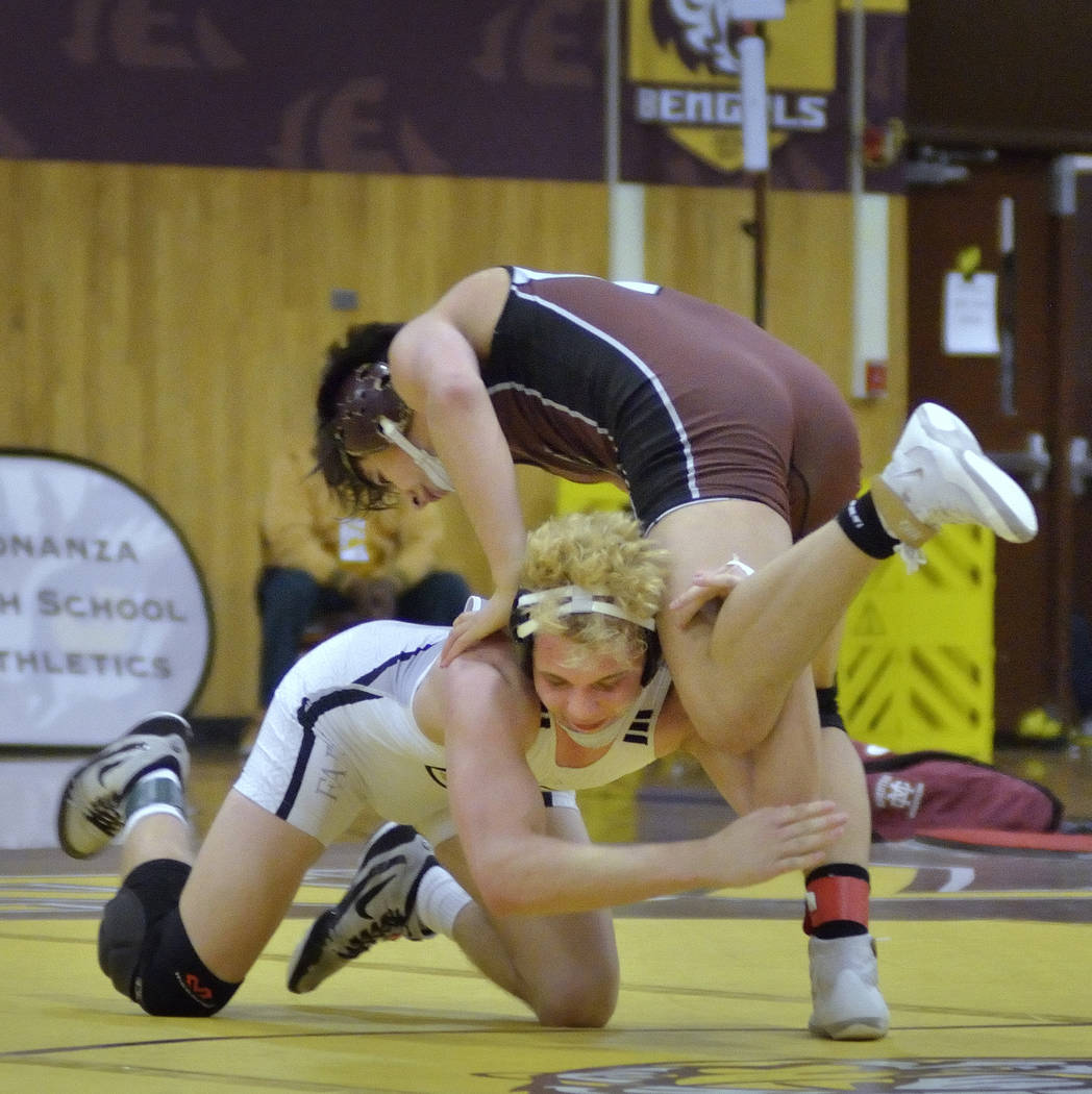 Daniel Rodriguez of Cimarron-Memorial High School, top, and Carson Cook from Faith Lutheran ...