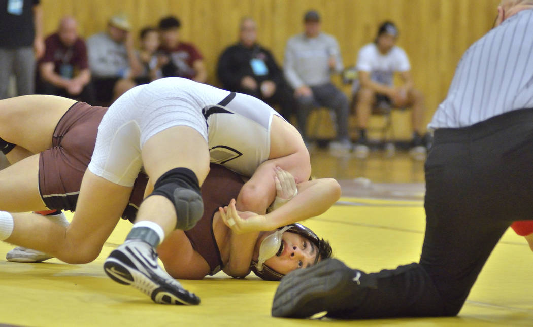 Daniel Rodriguez of Cimarron-Memorial High School, bottom, and Carson Cook from Faith Luther ...