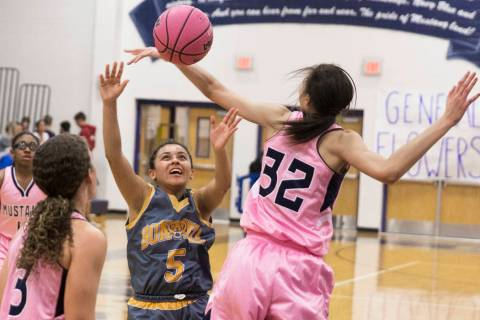 Bonanza sophomore Isaira Diaz (5) fights for a rebound with Shadow Ridge junior Christina Th ...