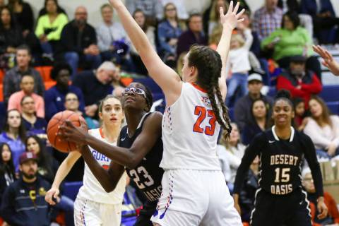 Desert Oasis' Desi-Rae Young, left, looks to shoot against Bishop Gorman's Tiern ...