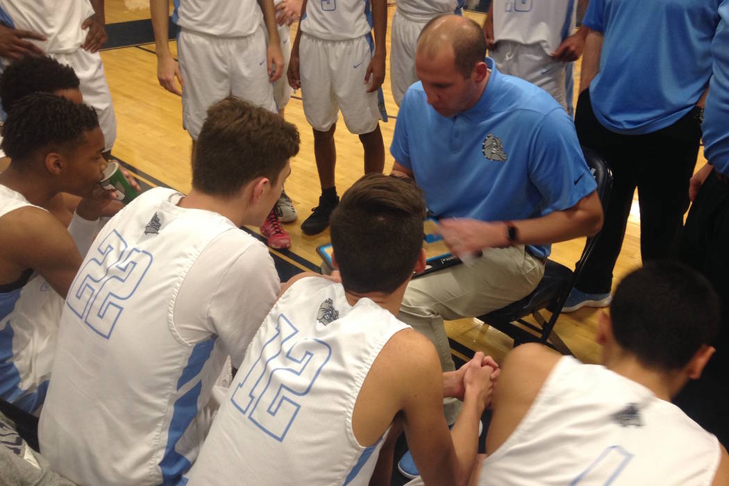 Centennial coach Noah Hartsock draws up a play during a timeout in the first quarter of Cent ...