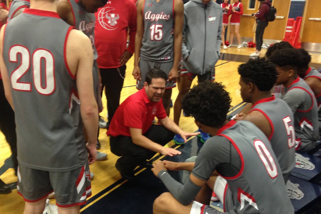 Arbor View coach Dustin Clayton gives instructions during a timeout in the first quarter of ...
