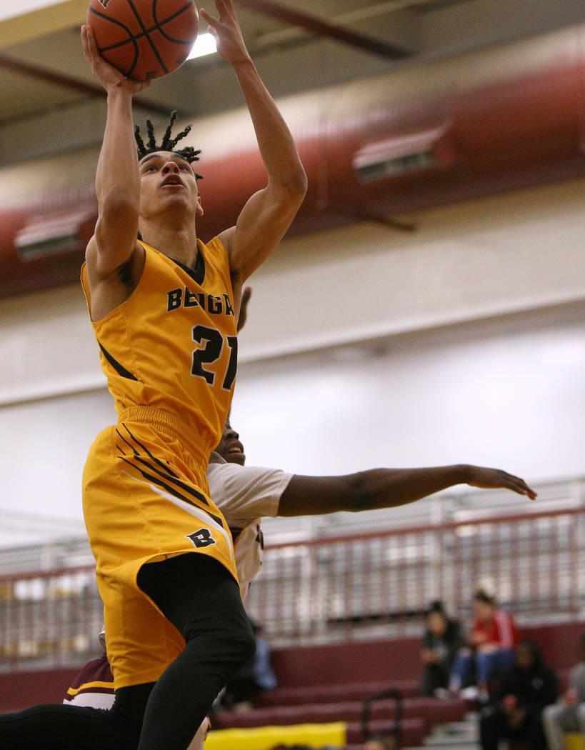 Bonanza's Trent Savage (21) jumps up to take a shot during a game at Eldorado High Sch ...