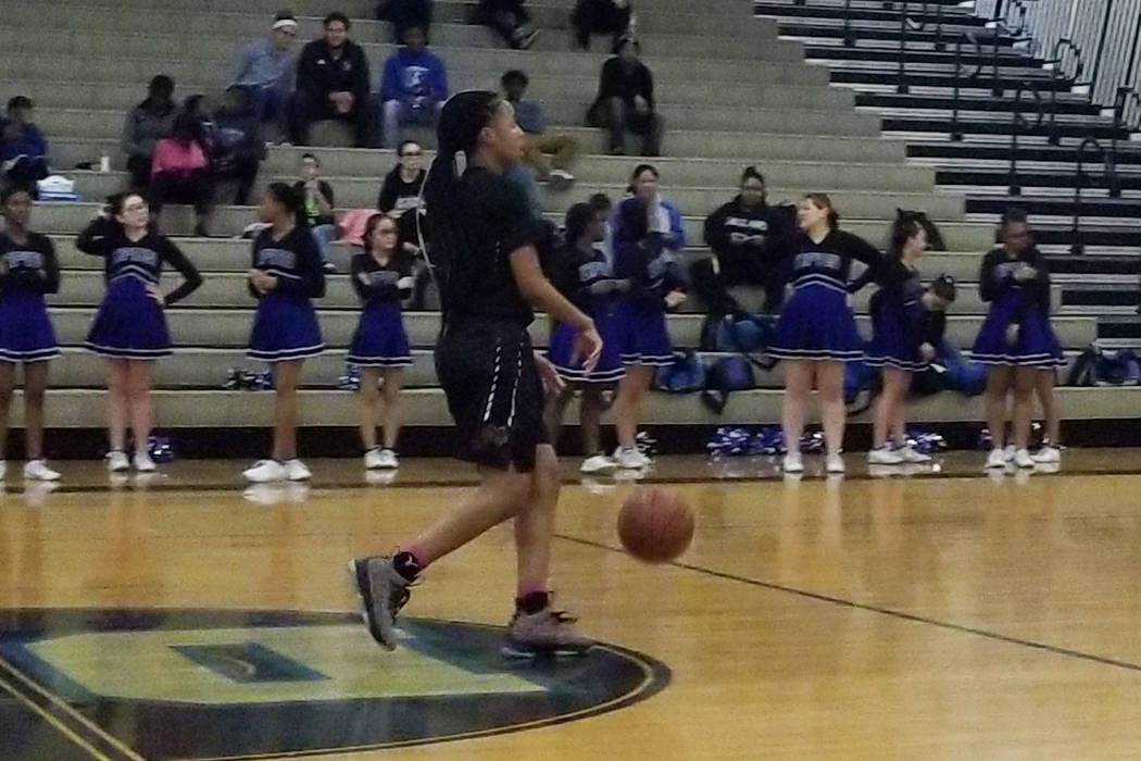 Cimarron-Memorial's Yesenia Wesley-Nash brings the ball down the floor on Tuesday at D ...