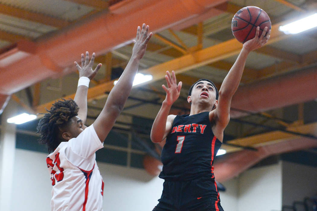 Liberty's Kobe Stroughter (1) shoots a lay up over Coronado's Jhaylon Martinez ( ...