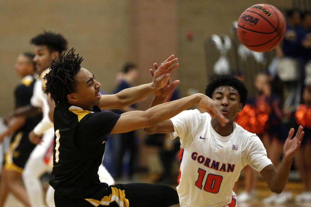 Clark's Frankie Collins (1) defends against Bishop Gorman's Zaon Collins (10) d ...