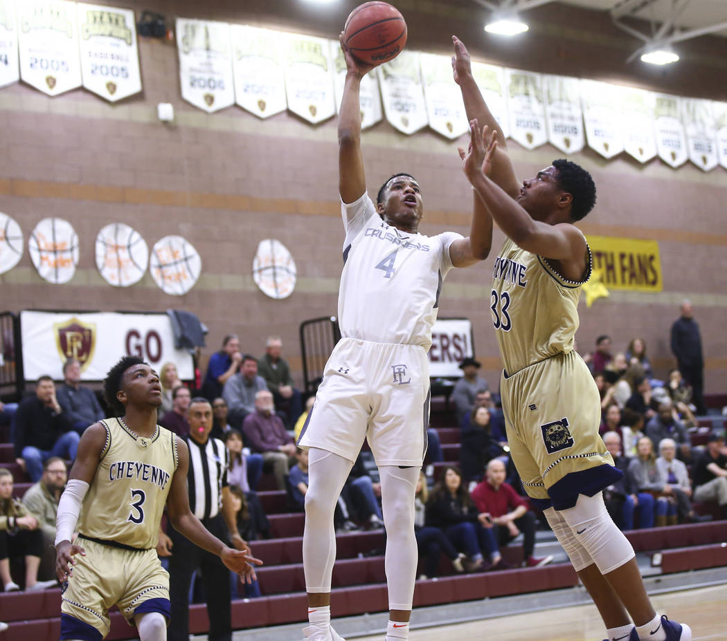 Faith Lutheran's Sedrick Hammond (4) goes to the basket against Cheyenne's Mike ...