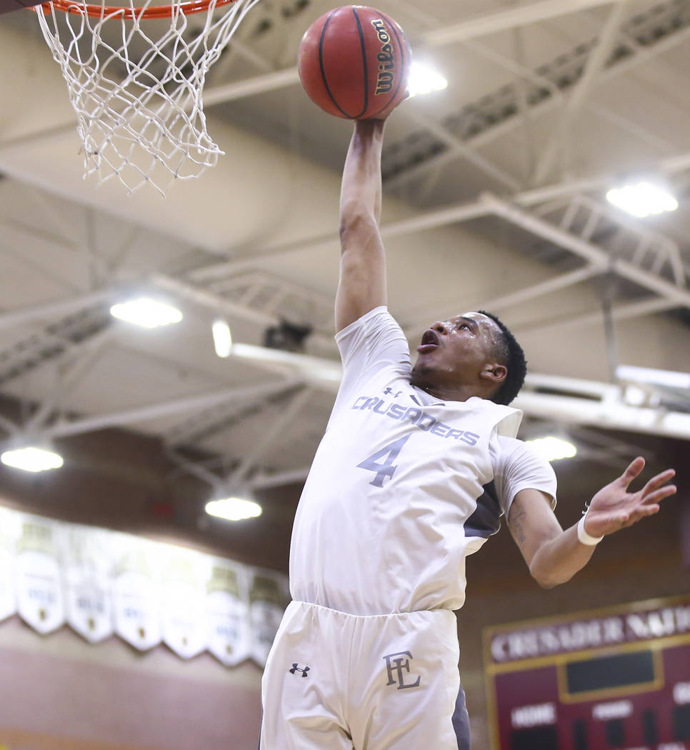 Faith Lutheran's Sedrick Hammond (4) goes to the basket against Cheyenne during the fi ...