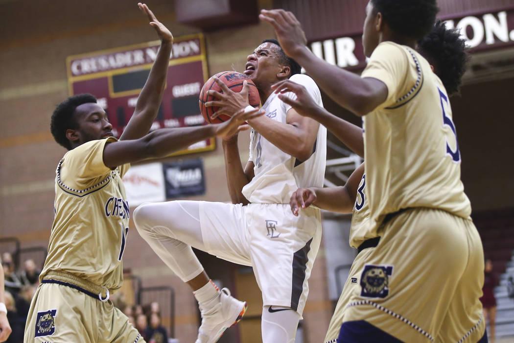 Faith Lutheran's Sedrick Hammond (4) goes to the basket against Cheyenne's De&#8 ...