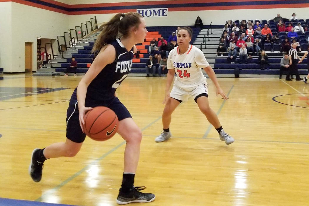 Foothill's Aqui Williams, left, brings the ball down the court as Bishop Gorman' ...