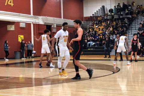 Clark senior Antwon Jackson plays defense in the third quarter of a 69-47 victory over Liber ...