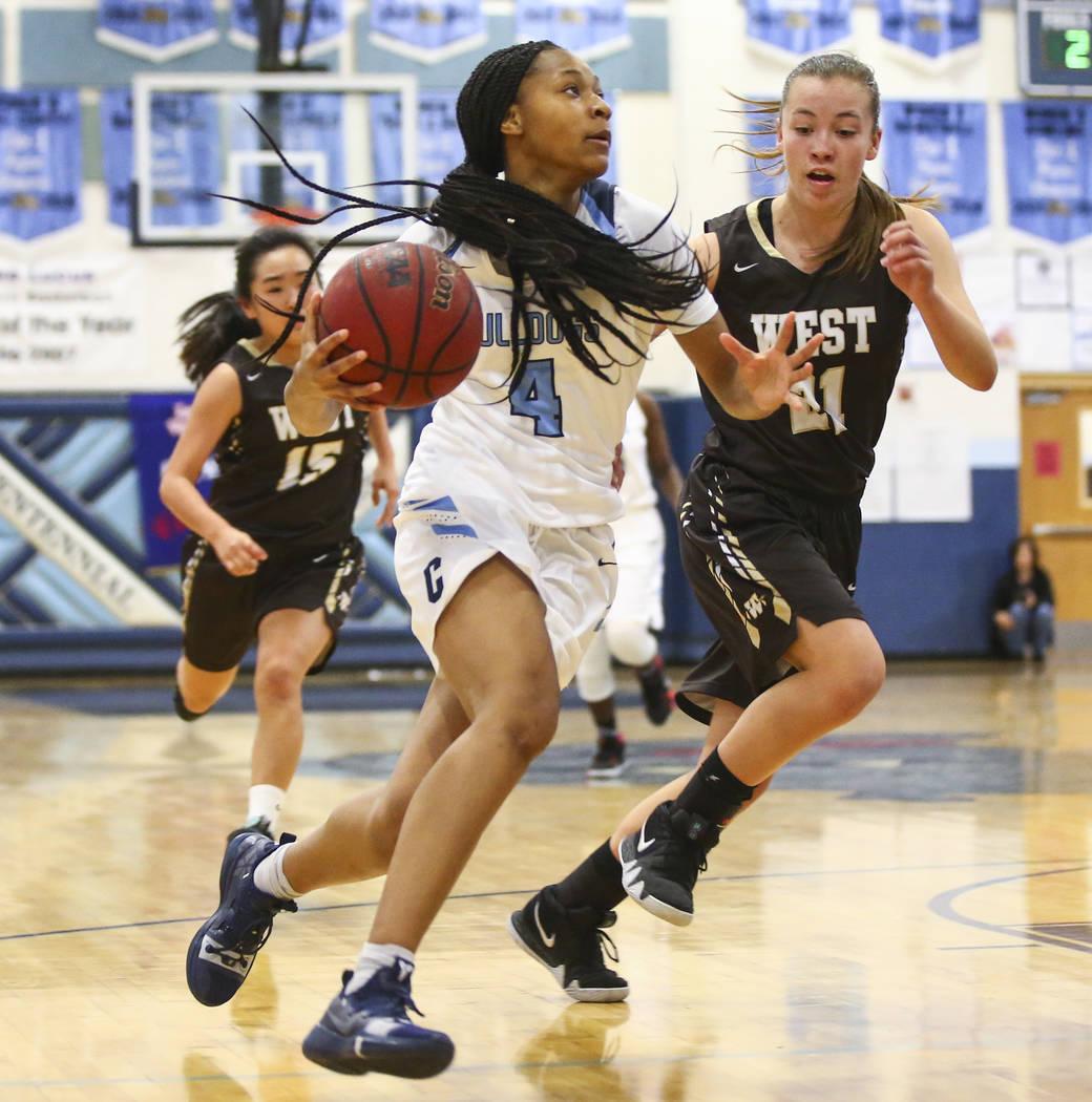 Centennial's Taylor Bigby (4) drives to the basket against WestÕs Ella Estabrook (21) ...