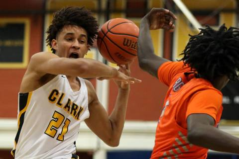 Clark's Jalen Hill (21) runs down the court with the ball during a basketball game at ...