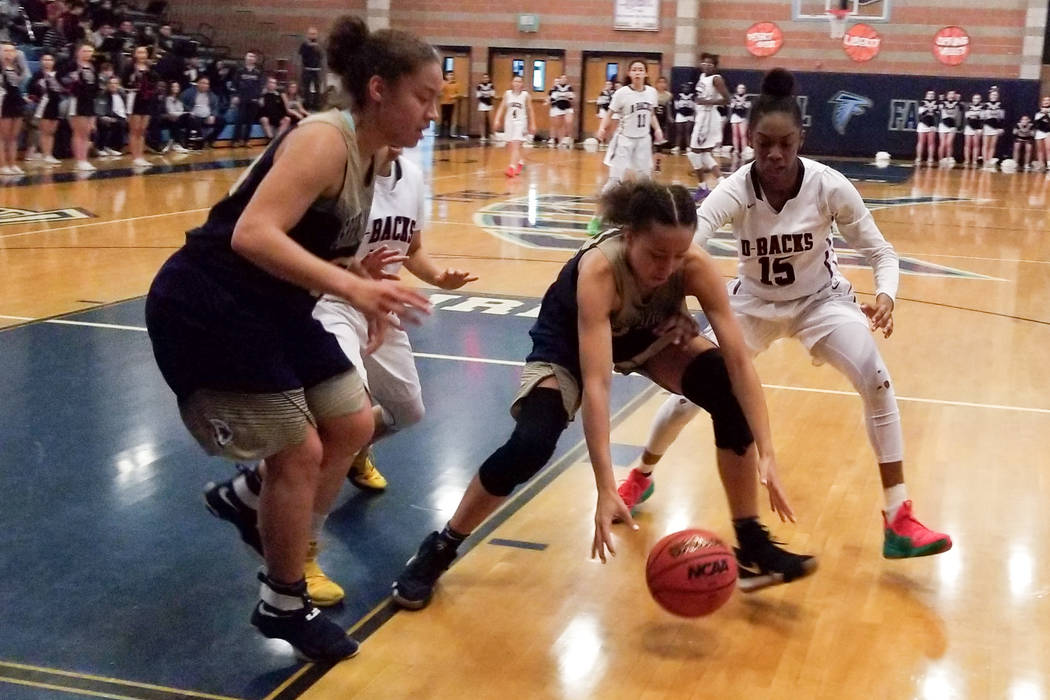 Spring Valley's Garrisen Freeman tries to scoop up a loose ball as Desert Oasis' ...