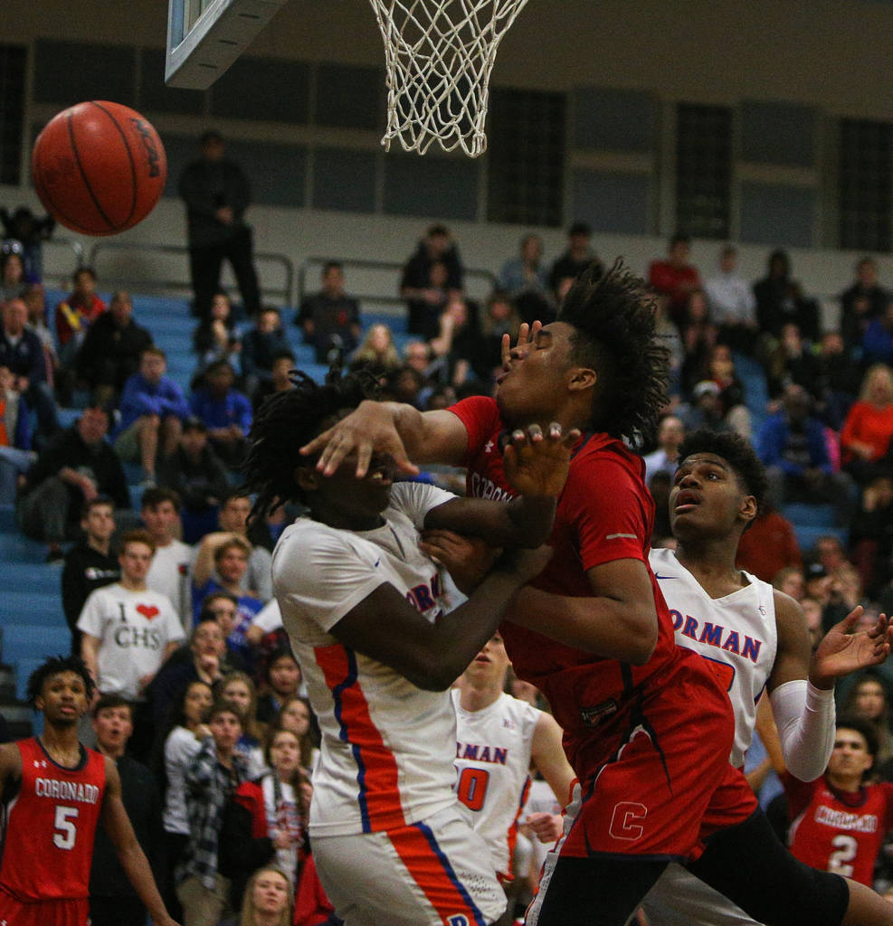 Bishop Gorman's Will McClendon (1) swats the ball out of the hands of Coronado's ...