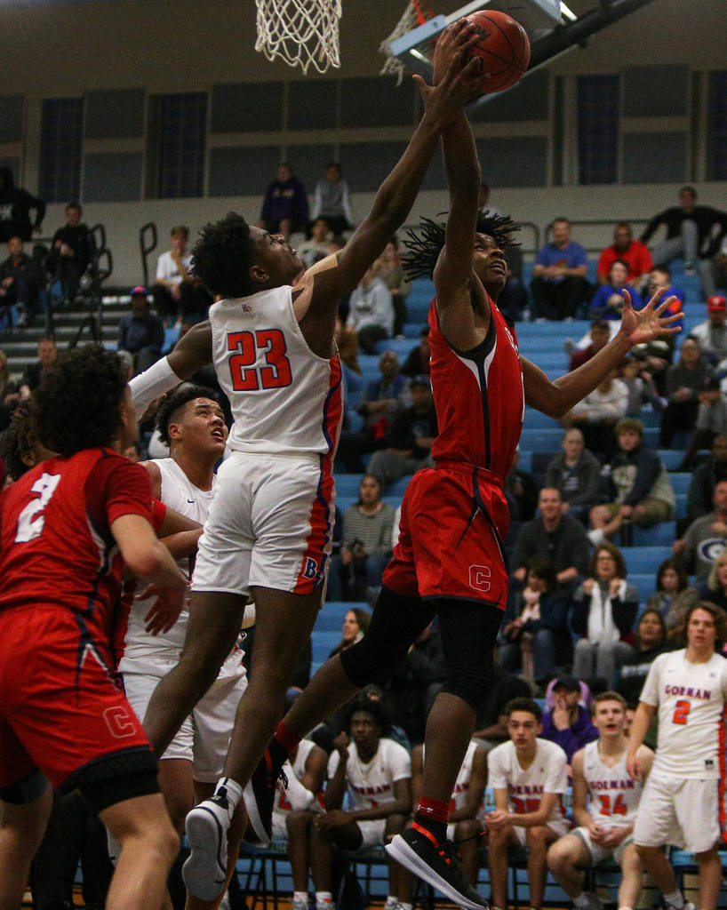 Coronado's Jaden Hardy (1) jumps up to take a shot while being guarded by Bishop Gorma ...