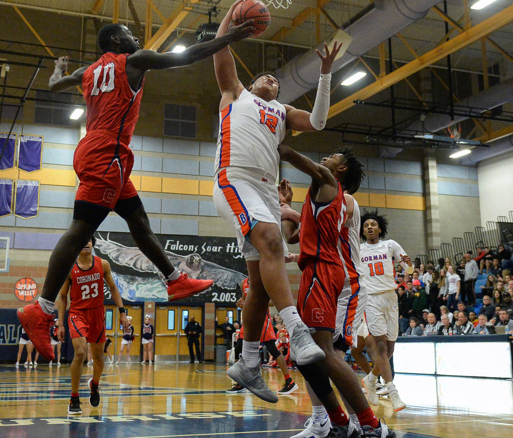 Coronado's Tyrell Hunt (10) knocks the ball out of the hands of Bishop Gorman's ...