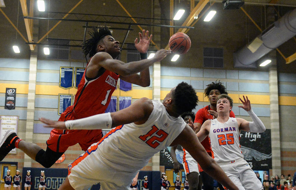 Coronado's Jaden Hardy (1) loses possession of the ball as Bishop Gorman's Max A ...