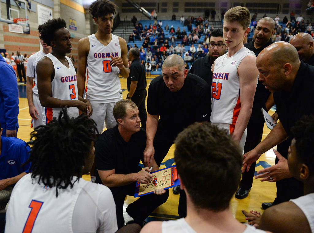 Bishop Gorman's coaches talk to the team during a timeout during a game against Corona ...