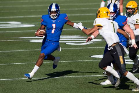 Bishop Gorman quarterback Micah Bowens (1) runs the ball against Bishop Manogue's Elij ...