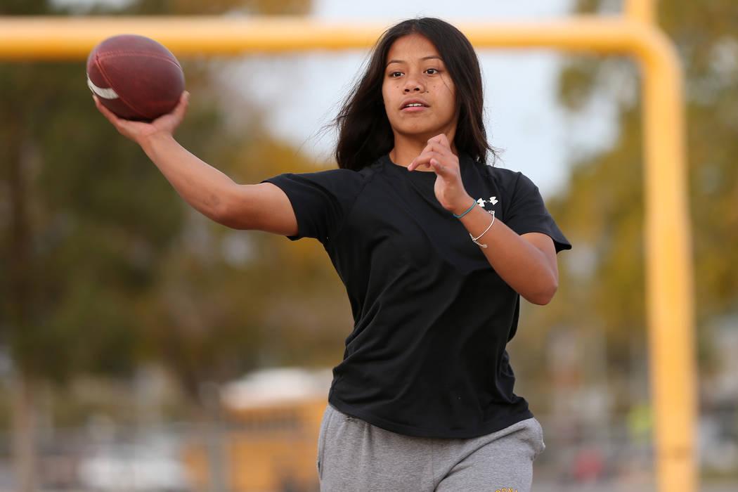 Bonanza's flag football quarterback Cindylou Rasiang, 15, throws a pass during a worko ...