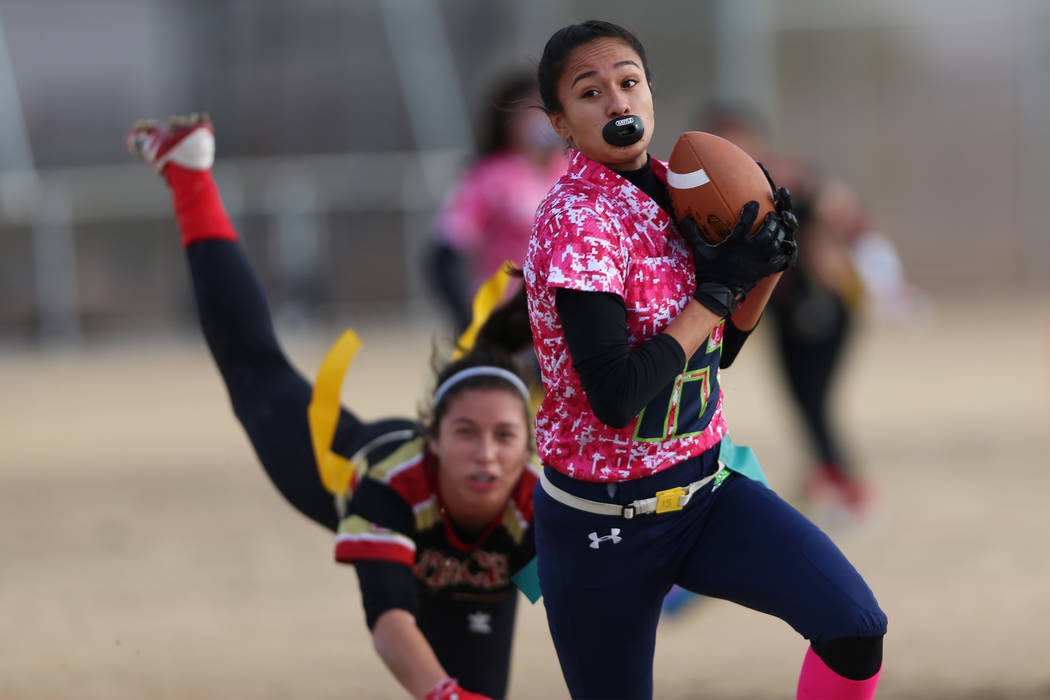 Green Valley junior Jazlyn Camacho (15) makes an interception against SECTA in the flag foot ...