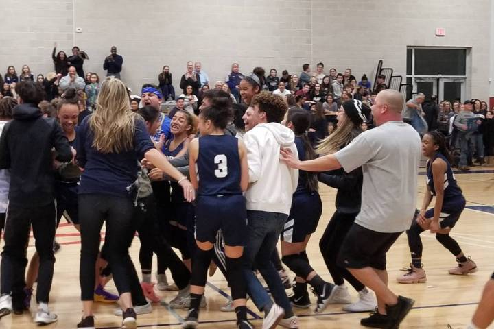 Calvary Chapel players and fans storm the court after the team's 47-43 win over Needle ...