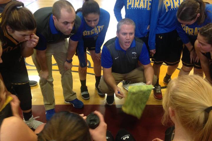 Moapa Valley coach Brandon Jones gives instructions between the first and second quarter of ...