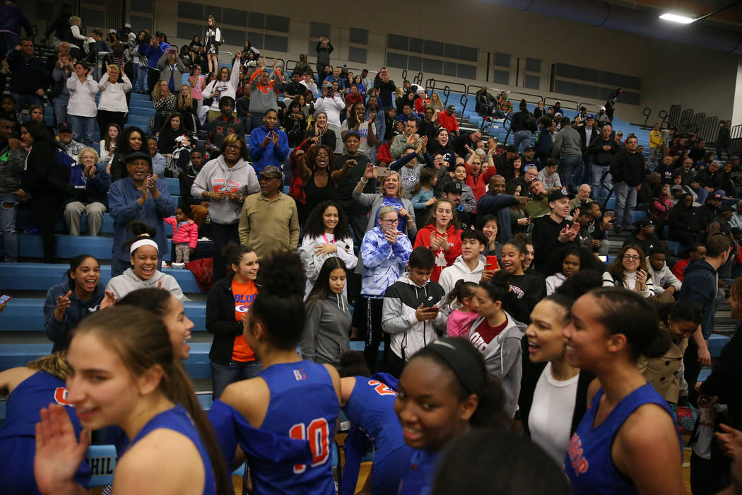 Fans celebrate with Bishop Gorman players after their win against Desert Oasis in the Desert ...