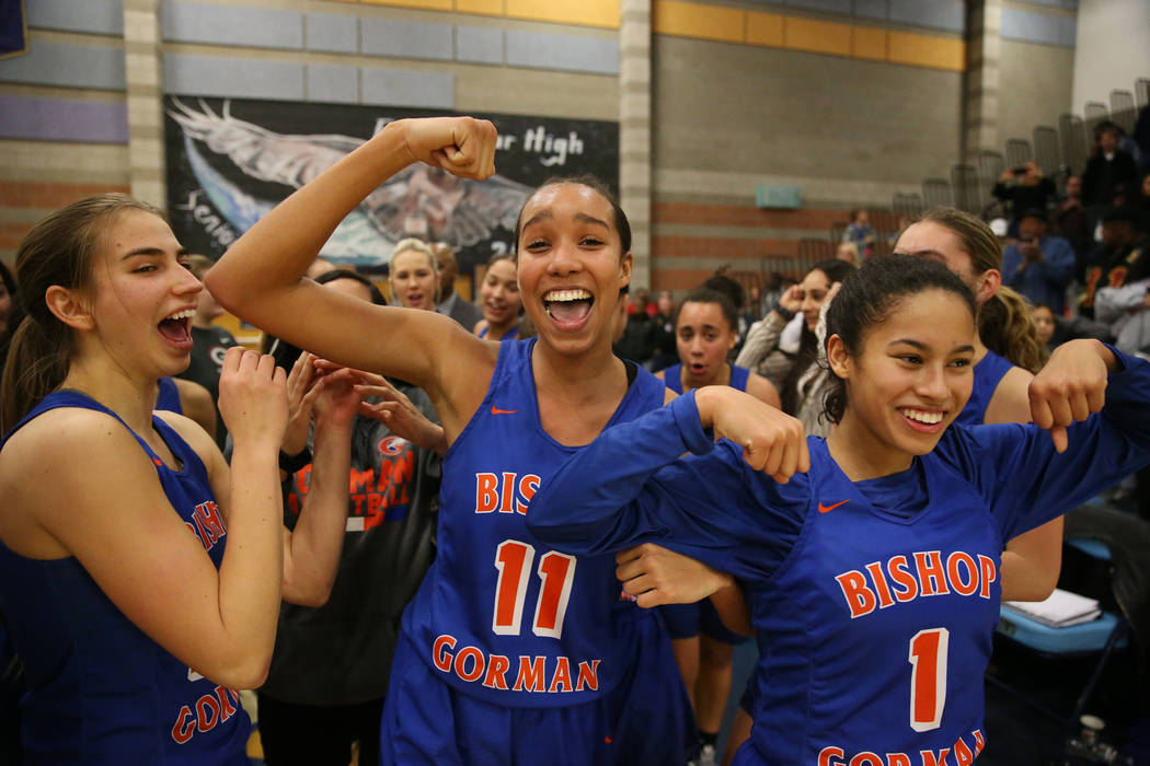 Bishop Gorman's Lexi Kruljac (22), Olivia Smith (11) and Caira Young (1), celebrate th ...