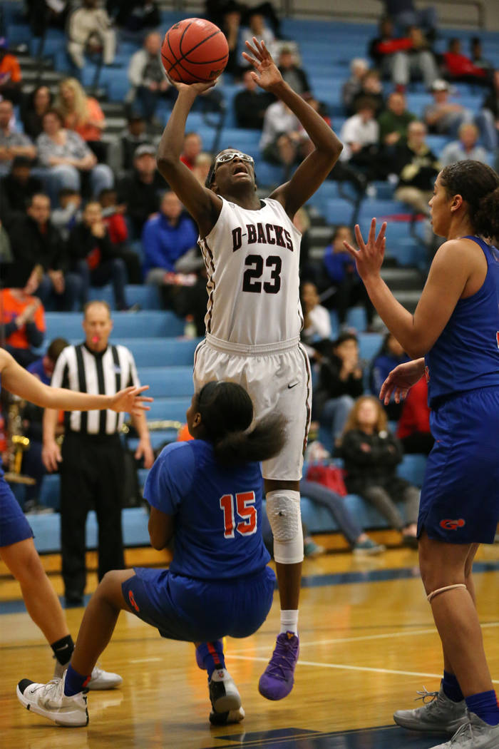 Bishop Gorman's Asya Bey (15) takes a charge from Desert Oasis' Desi-Rae Young ( ...