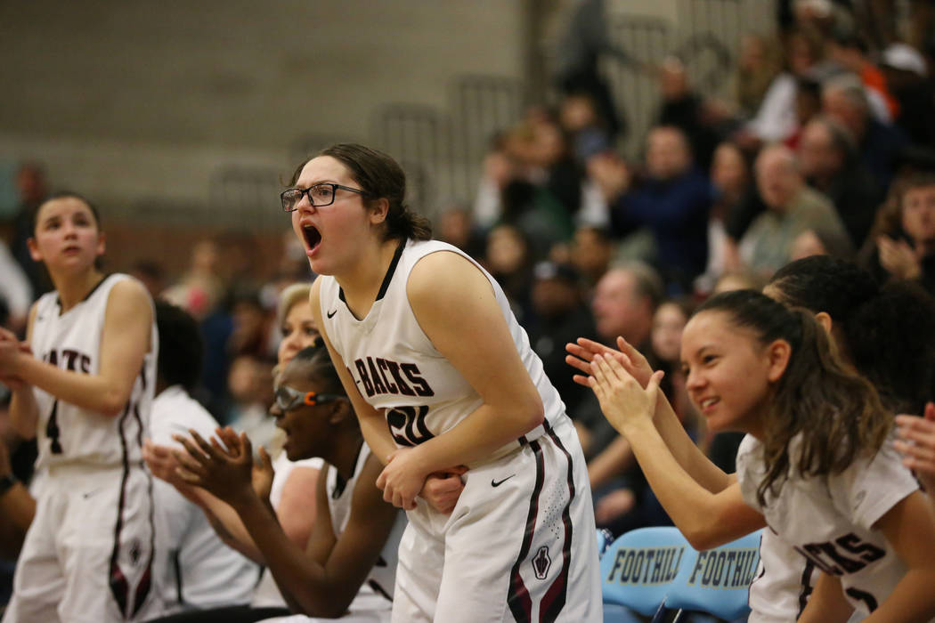 The Desert Oasis bench including Arrianna Spring (20), center, reacts after a play against B ...