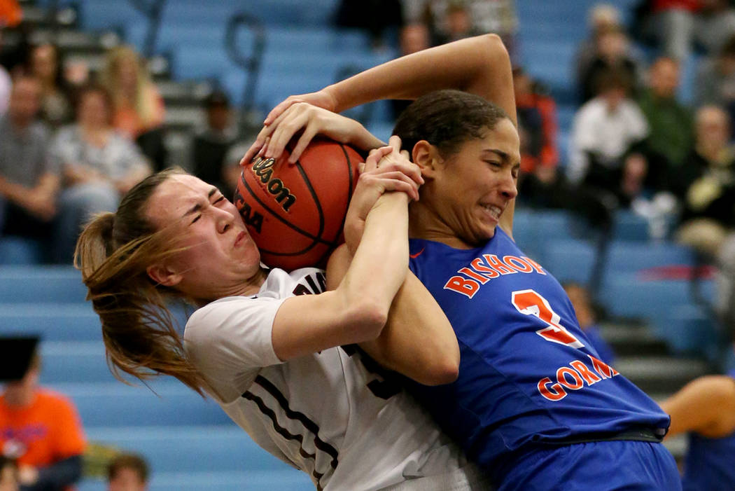 Desert Oasis' Sierra Mich'l (30) fights for the ball against Bishop Gorman&#8217 ...