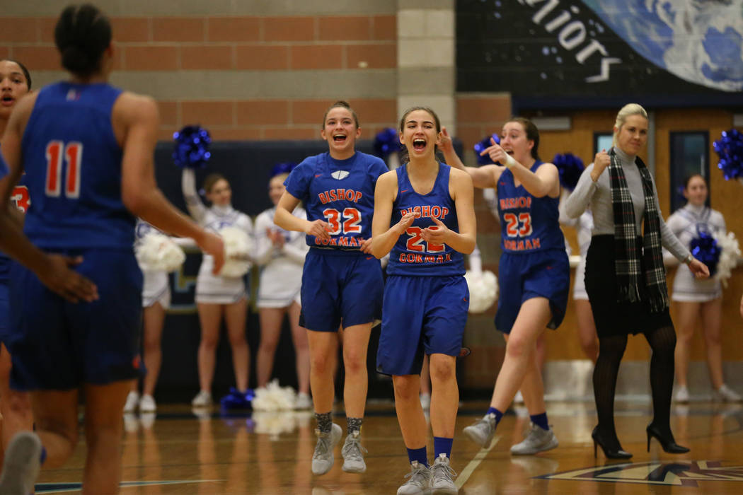 The Bishop Gorman bench reacts after a score by Olivia Smith (11) to beat the buzzer in the ...