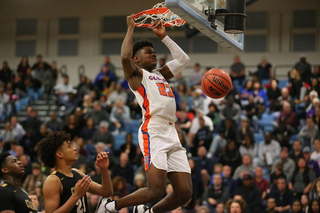 Bishop Gorman's Mwani Wilkinson (23) dunks the ball against Clark in the Desert Region ...