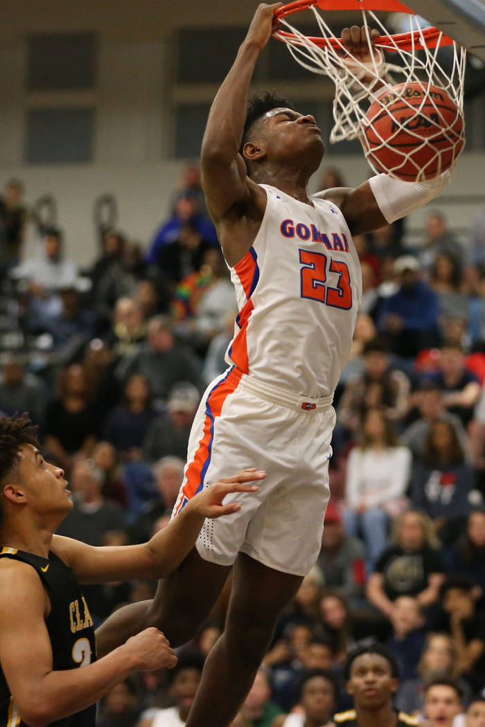 Bishop Gorman's Mwani Wilkinson (23) dunks the ball against Clark in the Desert Region ...