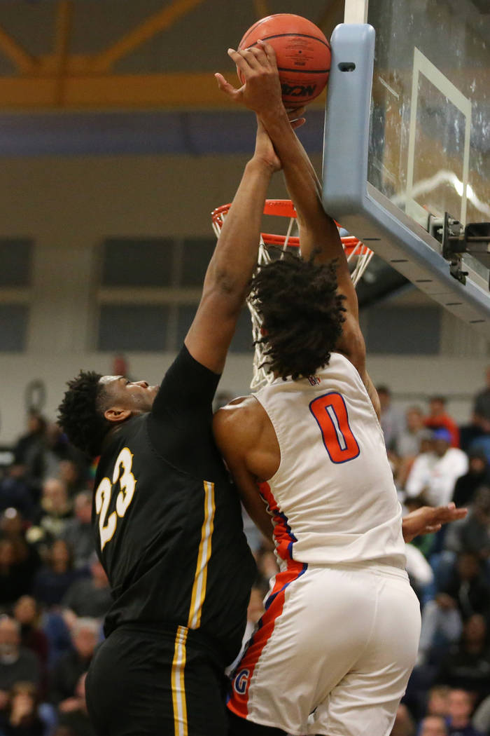 Clark's Antwon Jackson (23) makes a block against Bishop Gorman's Isaiah Cottrel ...